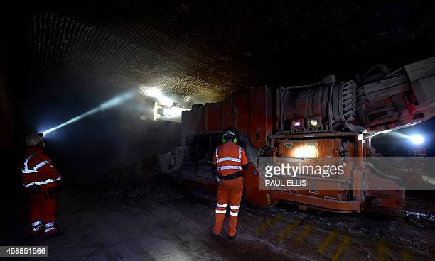 Miners work at the salt face 500 feet below the surface at the Compass Minerals Salt Mine in Winsford north west England on November 12 2014 The mine...