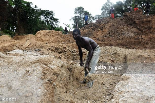 Miners work on the diamonds mine of Banengbele, 10 km south of Boda, on May 22, 2015 in Central African Republic. The country no longer exports...