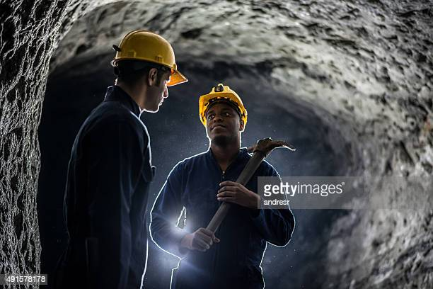 miners working at a mine - coal mining stock photos and pictures