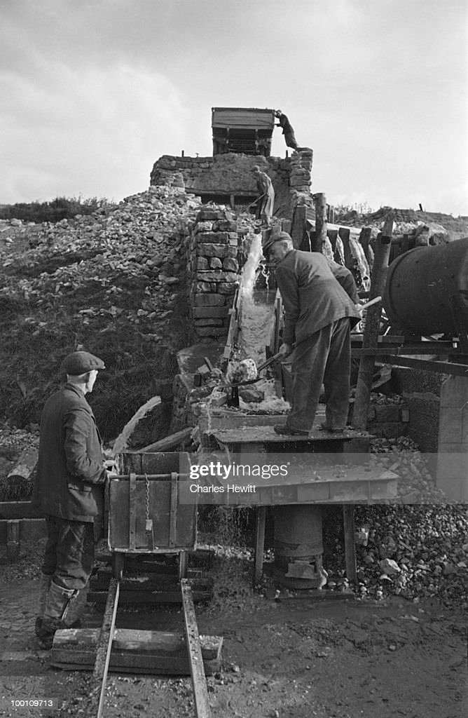 Miners working outside a baryte drift mine on the border between Westmorland and County Durham, February 1949. Original publication: Picture Post - 4712 - Britain's Loneliest Mine - 5th February 1949
