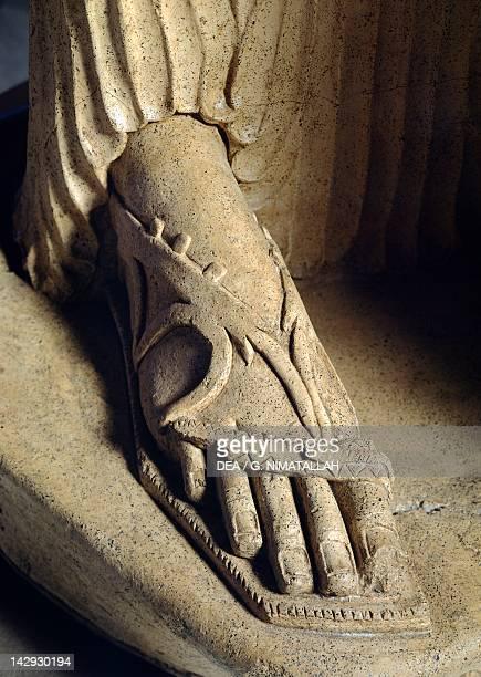 Minerva Tritonia terracotta statue from the site of LaviniumPratica di Mare Lazio Italy Detail of the sandal Latin Civilization 5th Century BC...