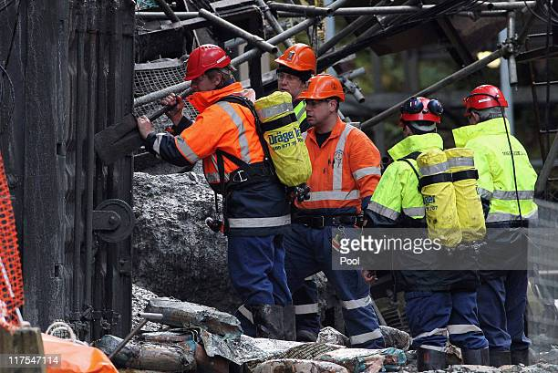Mines Rescue staff removes debris and rubble at the Pike River mine on June 28 2011 in Greymouth New Zealand Teams entered for the first time today...