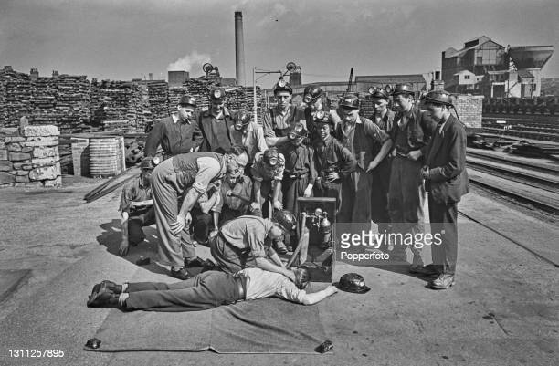 Mines safety engineer Mr P Hibbard gives a lecture lesson on resuscitation to a group of boy coal-mining recruits, some as young as fourteen, at...