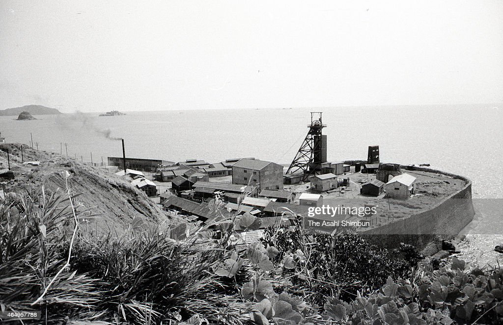 A mineshaft tower is seen at the industrial area of the Hashima on August 12, 1956 in Takashima, Nagasaki, Japan. The coal mining island, is also known as the Battleship Island, whose population used to be more than 5,000 in its heyday in 1959. In the residential area there were the Japan's first concrete building apartments.
