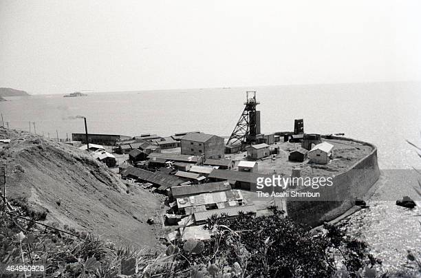 Mineshaft tower is seen at the industrial area of the Hashima on August 12, 1956 in Takashima, Nagasaki, Japan. The coal mining island, is also known...