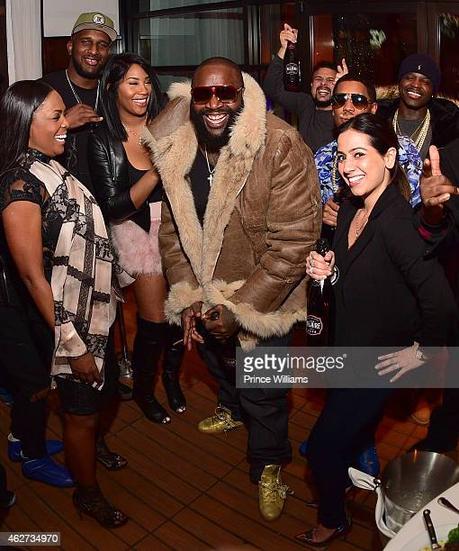 Ming Lee Rick Ross and Dina Marto attend Rick Ross's birthday dinner at Ocean Prime on February 3 2015 in Atlanta Georgia