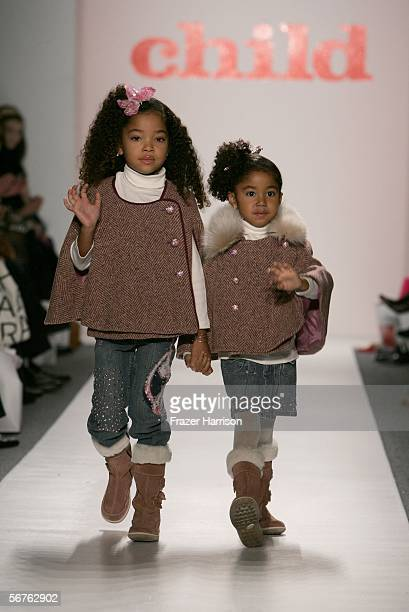 Ming Lee Simmons and Aoki Lee Simmons daughters of music producer Russell Simmons and fashion model wife Kimora Lee Simmons walk the runway at the...