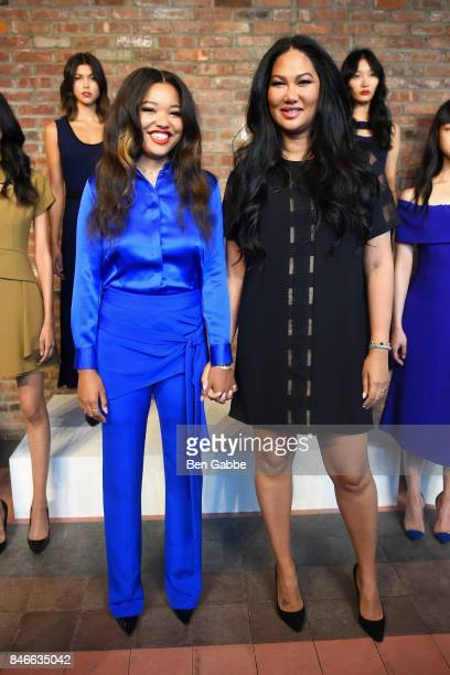 Ming Lee Simmons and designer Kimora Lee Simmons pose at the Kimora Lee Simmons Presentation during New York Fashion Week at The Bowery Hotel on...