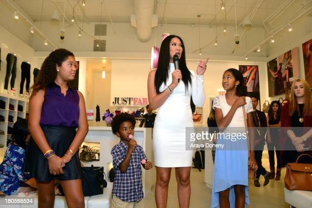 Ming Lee Simmons Kenzo Lee Hounsou Kimora Lee Simmons and Aoki Lee Simmons attend the JustFab Boutique grand opening with Kimora Lee Simmons at...