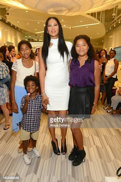 Ming Lee Simmons Kenzo Lee Hounsou Kimora Lee Simmons and Aoki Lee Simmons attend the JustFab Boutique grand opening with Kimora Lee Simmons at...