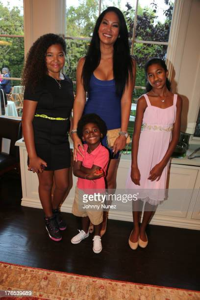 Ming Lee Simmons Kimora Lee Simmons Aoki Simmons and Kenzo Lee Hounsou attend the Foundation For Ethnic Understanding Benefit on August 14 2013 in...