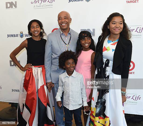 Ming Lee Simmons Russell Simmons Kenzo Lee Hounsou and Aoki Lee Simmons attend the 15th annual Art For Life Benefit at Fairview Farms on July 26 2014...