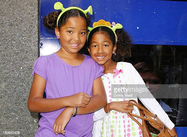 """Ming Simmons and Aoki Simmons pose after seeing """"Shrek The Musical"""" at the Broadway Theatre on August 15, 2009 in New York City."""
