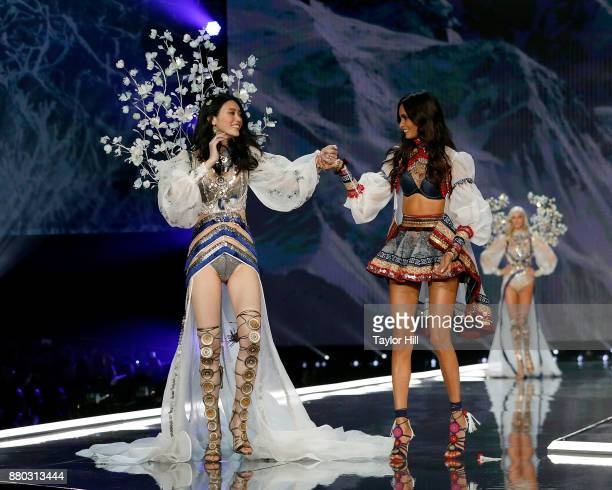 Ming Xi and Gizele Oliveira walk the runway during the 2017 Victoria's Secret Fashion Show at MercedesBenz Arena on November 20 2017 in Shanghai China