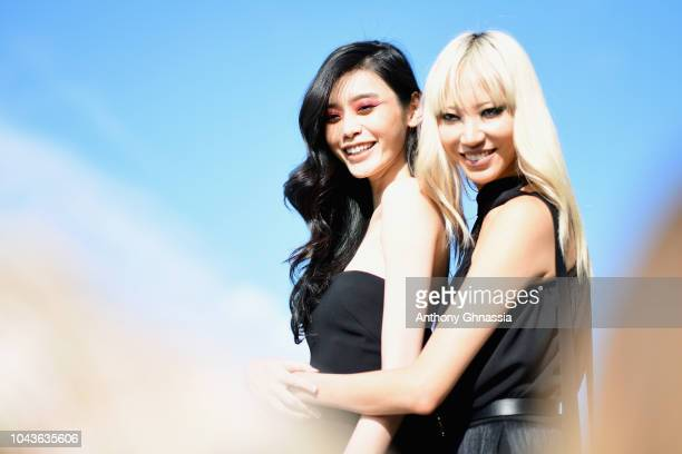 Ming Xi and Soo Joo Park attend Le Defile L'Oreal Paris as part of Paris Fashion Week Womenswear Spring/Summer 2019 on September 30 2018 in Paris...