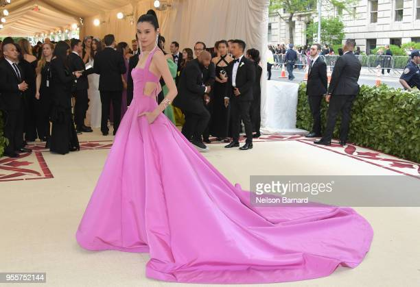 Ming Xi attends the Heavenly Bodies Fashion The Catholic Imagination Costume Institute Gala at The Metropolitan Museum of Art on May 7 2018 in New...