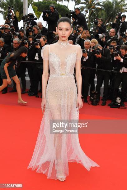 Ming Xi attends the screening of A Hidden Life during the 72nd annual Cannes Film Festival on May 19 2019 in Cannes France
