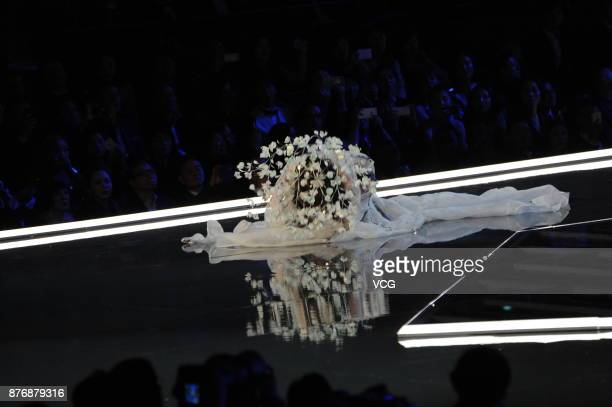 Ming Xi falls down on runway during the 2017 Victoria's Secret Fashion Show at MercedesBenz Arena on November 20 2017 in Shanghai China