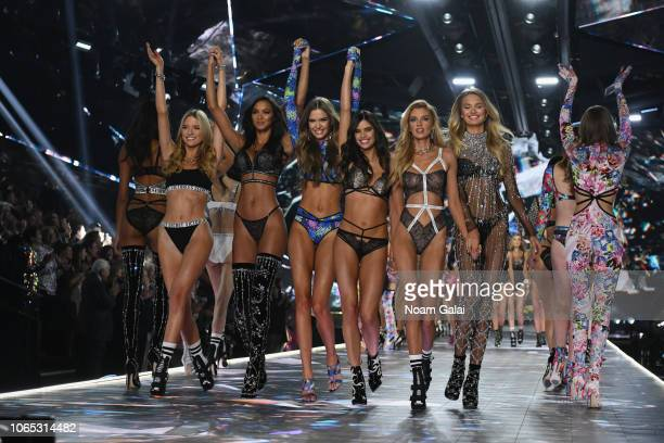 Ming Xi Grace Elizabeth Cindy Bruna Sara Sampaio Stella Maxwell and Romee Strijd walk the runway during the 2018 Victoria's Secret Fashion Show at...