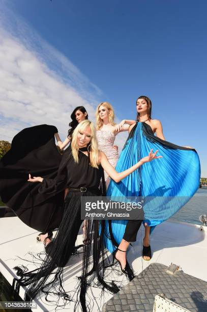 Ming Xi Soo Joo Park Elle Fanning and Luma Grothe attend Le Defile L'Oreal Paris as part of Paris Fashion Week Womenswear Spring/Summer 2019 on...
