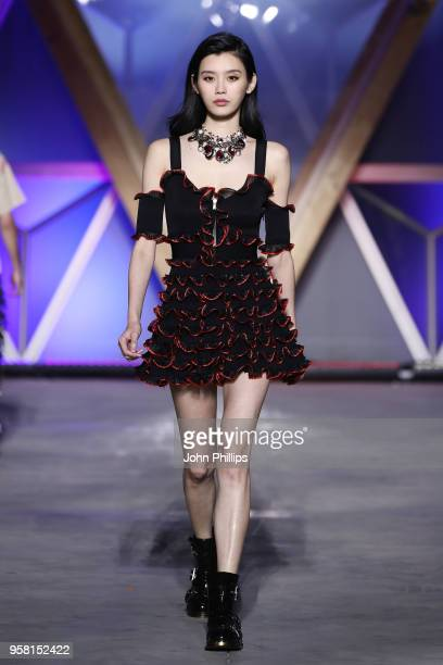 Ming Xi walks the Runway at Fashion for Relief Cannes 2018 during the 71st annual Cannes Film Festival at Aeroport Cannes Mandelieu on May 13 2018 in...