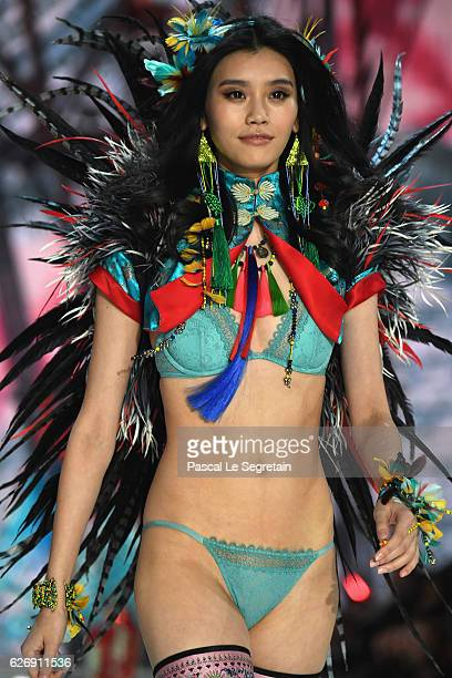 Ming Xi walks the runway at the Victoria's Secret Fashion Show on November 30 2016 in Paris France