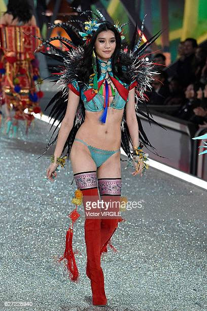 Ming Xi walks the runway during the 2016 Victoria's Secret Fashion Show on November 30 2016 in Paris France