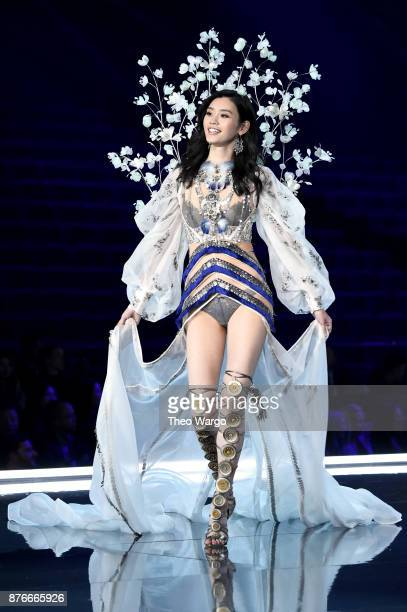 Ming Xi walks the runway during the 2017 Victoria's Secret Fashion Show In Shanghai at MercedesBenz Arena on November 20 2017 in Shanghai China
