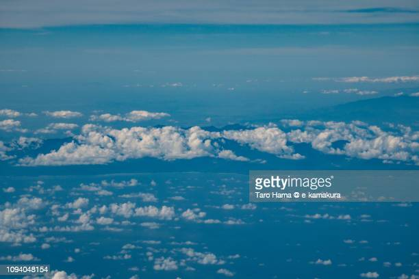 Mingan Mountains and Aurora Memorial National Park in Province of Aurora in Philippines daytime aerial view from airplane