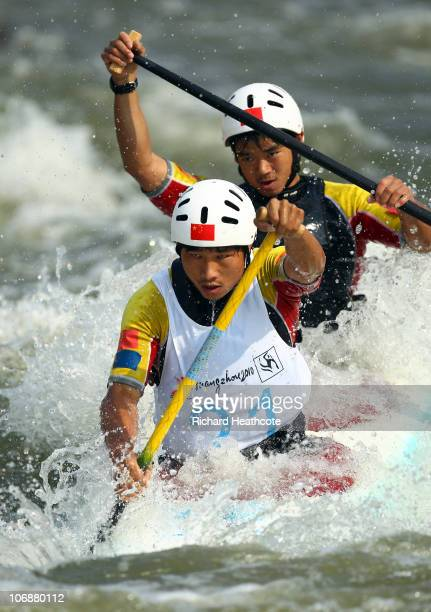 Minghai Hu and Junrong Shu of China compete in the Men's Canoe Double Heats at International Rowing Centre during day three of the 16th Asian Games...