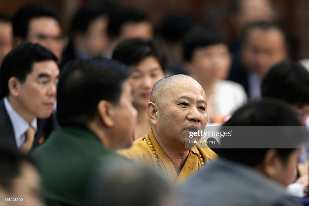 Mingsheng,Guangdong guangxiao Temple Abbot speaks during the Guangdong delegation's group meeting during the annual National People's Congress on March 6, 2013 in Beijing, China.Guangdong's gross domestic product (GDP) reached 5.7 trillion yuan in 2012.