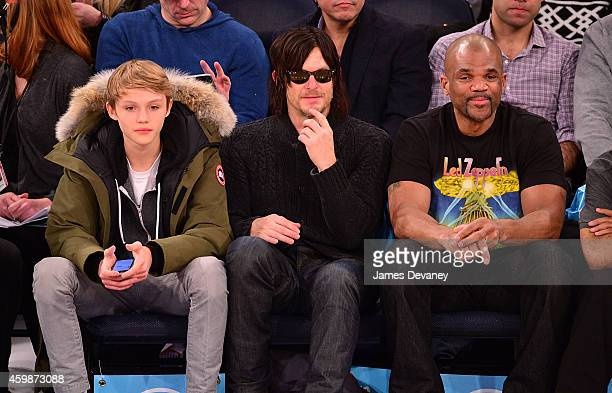 Mingus Reedus Norman Reedus and Darryl McDaniels attend the Brooklyn Nets vs New York Knicks game at Madison Square Garden on December 2 2014 in New...