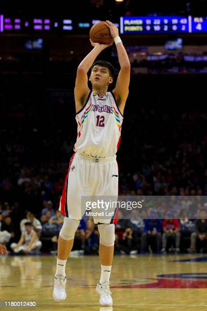Mingyang Sun of the Guangzhou Long Lions shoots the ball against the Philadelphia 76ers during the preseason game at the Wells Fargo Center on...