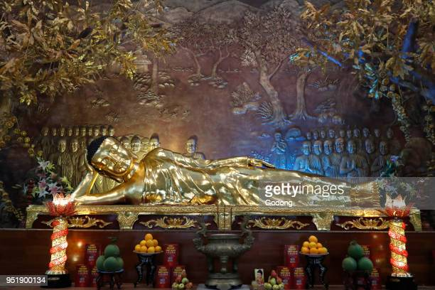 Minh Dang Quang buddhist temple Golden reclining Buddha statue After 45 years of teaching the Dharma the Buddha passed into Parinirvana Ho Chi Minh...