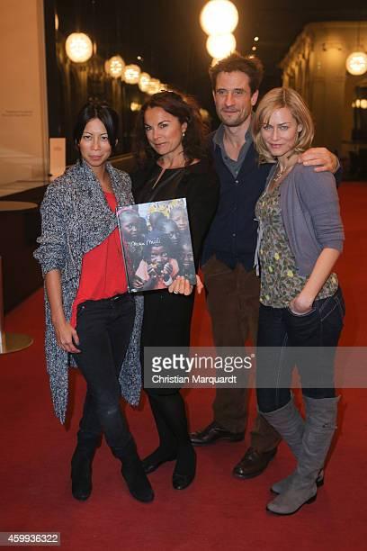 MinhKhai PhanThi Anna von Griesheim Oliver Mommsen and Gesine Cukrowski attend the 'Mein Mali' Book Presentation at Komische Oper on December 4 2014...