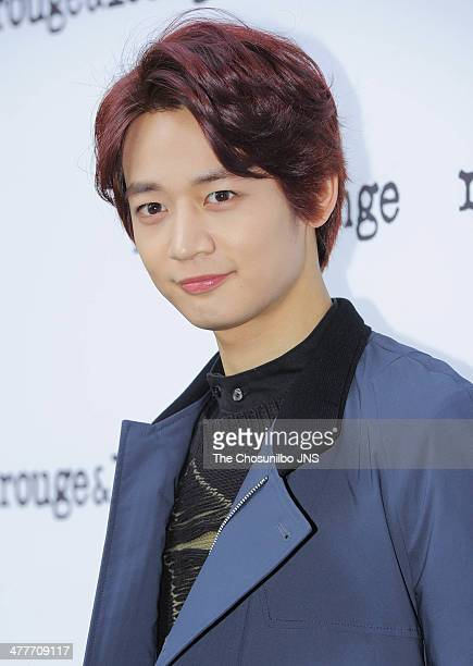 MinHo of SHINee poses for photographs during the RougeLounge 2014 S/S collection at Vogoze on March 7 2014 in Seoul South Korea