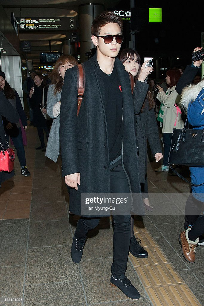 Minho of South Korean boy band SHINee is seen upon arrival from Japan at Gimpo International Airport on March 30, 2013 in Seoul, South Korea.