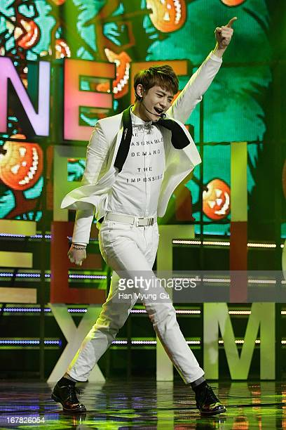 Minho of South Korean boy band SHINee performs onstage during the MBC Music 'Show Champion' at AXUniqlo Hall on May 1 2013 in Seoul South Korea