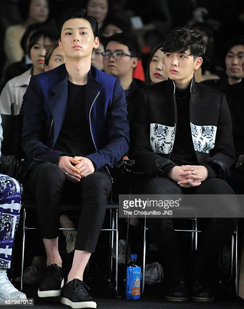 MinHyun and REN of NU'EST attend the 2015 S/S Seoul Fashion Week Kwak Hyunjoo collection at DDP on October 21 2014 in Seoul South Korea