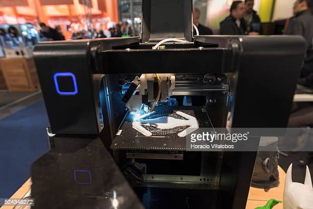 UP Mini 3D printer at work in Tiertime stand of Euromold 2014 Frankfurt Germany 27 November 2014 EuroMold is the world trade fair for Moldmaking and...