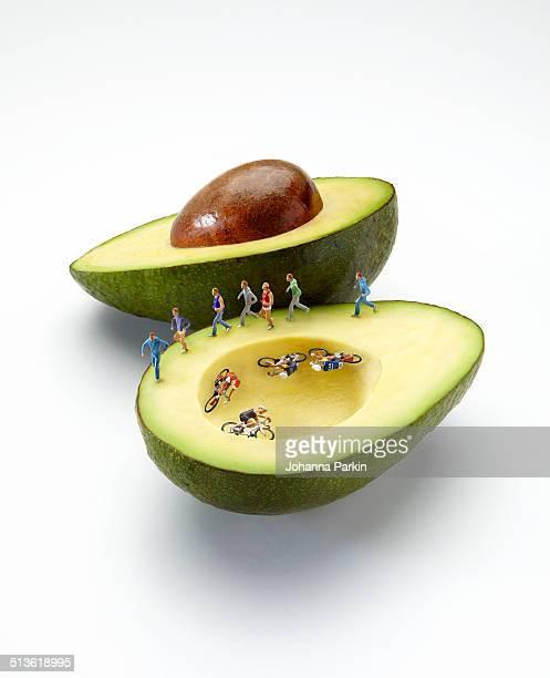 Mini athletes on avocado velodrome / running track
