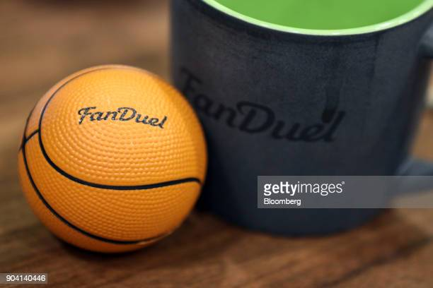 A mini basketball and a coffee mug sit on an employee's desk at Fanduel Inc's offices in Edinburgh UK on Tuesday Feb 7 2017 More coders are choosing...