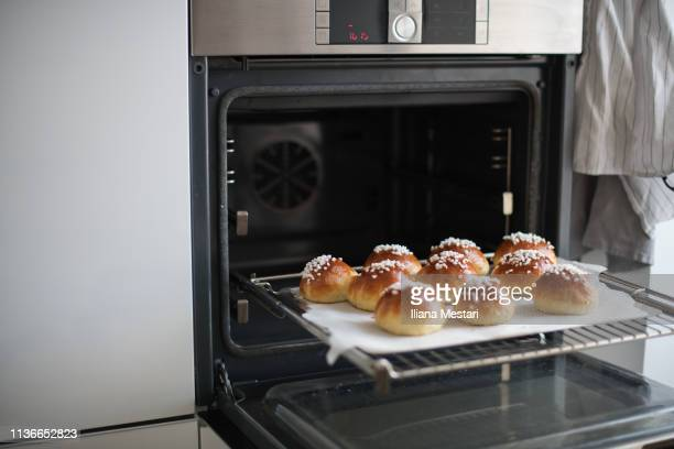 mini brioches coming out of the oven - brioche stock pictures, royalty-free photos & images