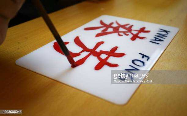 Mini bus sign maker Mak Kamseng works on a mini bus sign for Kwai Fong line in his workshop in Yau Ma Tei Hong Kong 16AUG17 [FEATURES] SCMP /...