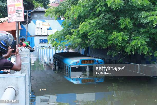 Mini bus submerged through a waterlogged street in floodwaters following rain in Kolkata.