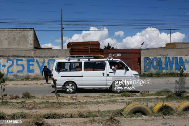 A mini bus transports coffins before the funeral of people killed yesterday during clashes between supporters of Evo Morales and security forces in...