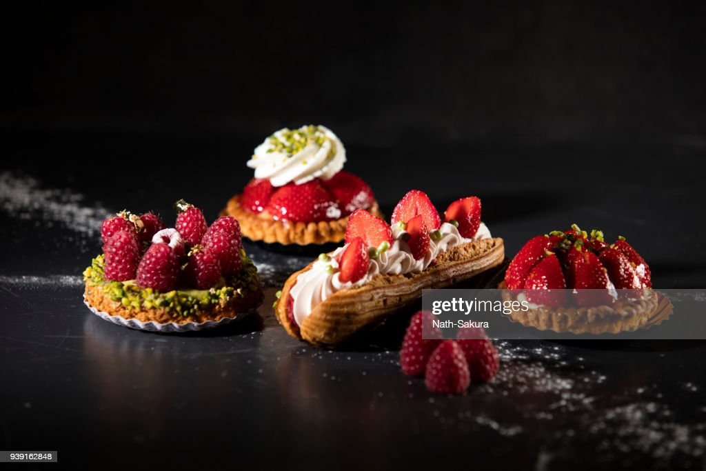 mini cake assortment with red fruits : Stock Photo