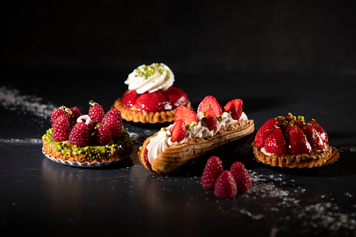 mini cake assortment with red fruits 939162848