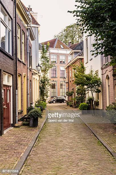 mini car parked at the end of a city street - zwolle stock photos and pictures
