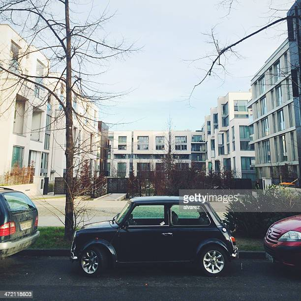 Mini car parked in front of residential complex